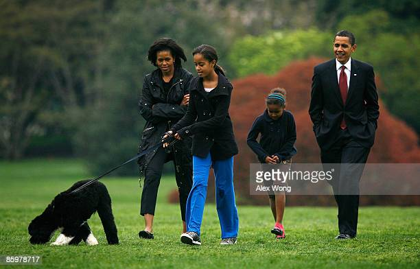 S President Barack Obama first lady Michelle and their daughters Malia and Sasha introduce their new dog a Portuguese water dog named Bo to the White...