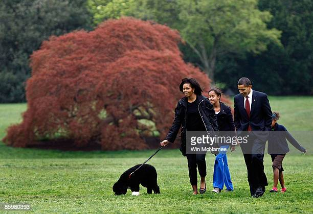 S President Barack Obama First Lady Michelle and their daughters Sasha and Malia introduce their new dog a Portuguese water dog named Bo to the White...