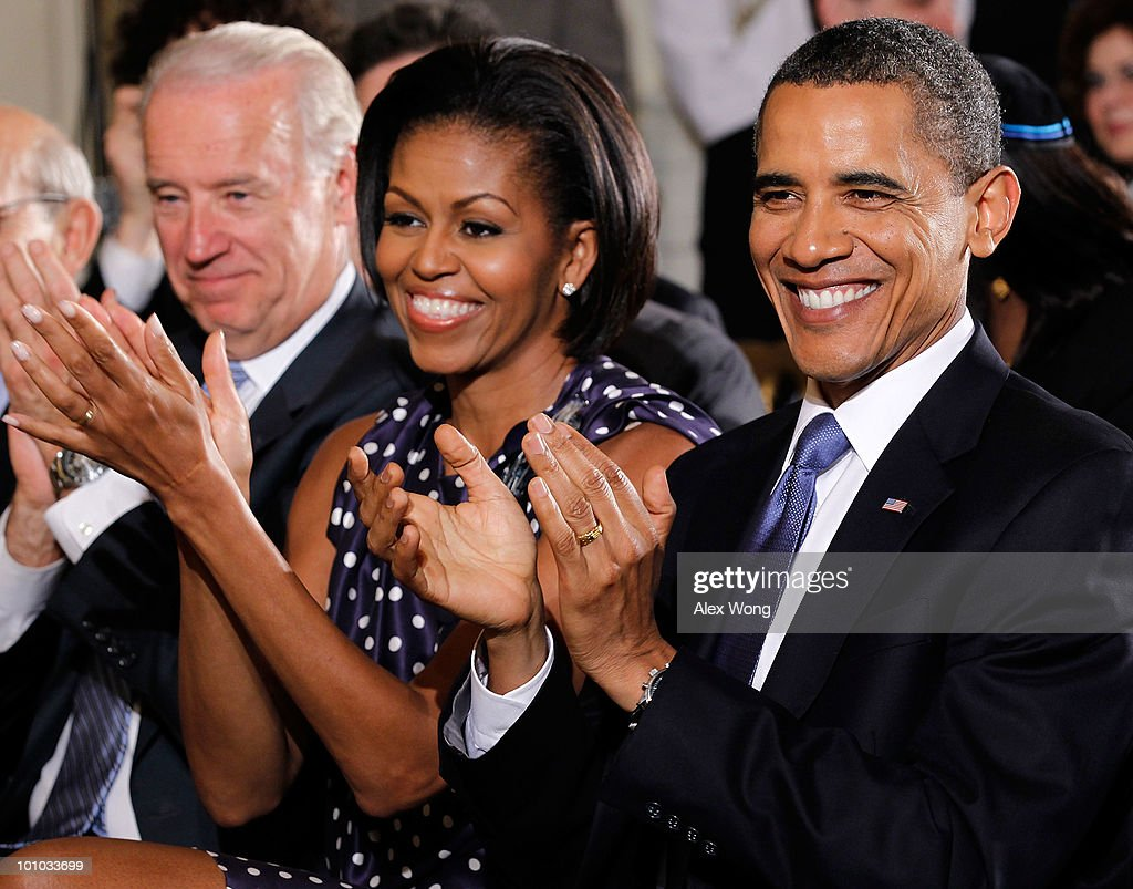 U.S President Barack Obama (R), first lady Michelle (C), and Vice President Joseph Biden (L) watch performance during a reception in honor of Jewish American Heritage Month May 27, 2010 in the East Room of the White House in Washington, DC. The reception was to celebrate Jewish American heritage and its contributions to American culture.