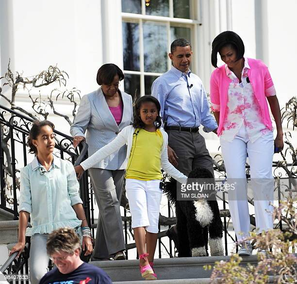 US President Barack Obama first lady Michelle first dog Bo daughters Sasha and Malia and Marian Robinson mother of Mrs Obama walk down the stairs...