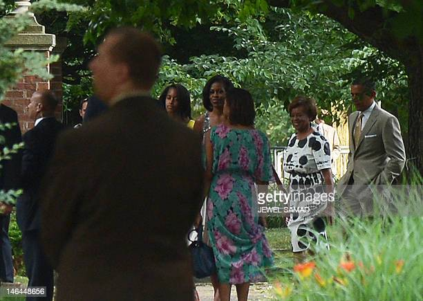 President Barack Obama First Lady Michelle Obama along with other First Family members walk to Valerie Jarrett's house to attend her daughter Laura...