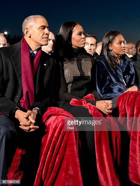 S President Barack Obama first lady Michelle Obama and daughter Sasha Obama attend the National Christmas Tree Lighting on the Ellipse December 1...