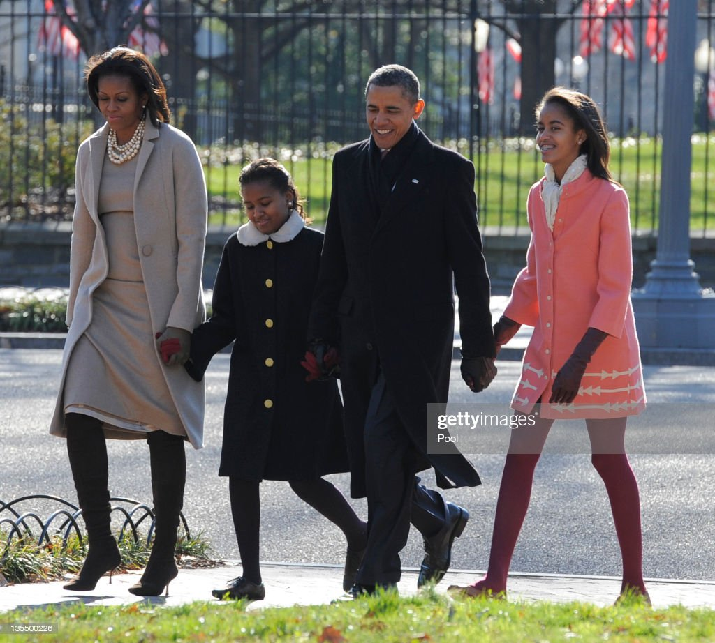 U.S. President Barack Obama, first lady Michelle Obama (L) and daughters Malia Obama (R) and Sasha Obama (2L) walk from the White House across Lafayette Park to St. John's Church for Sunday services December 11, 2011 in Washington, DC. Obama stance on faith was attacked in a commercial by Rick Perry, claiming he has a 'war on religion'.