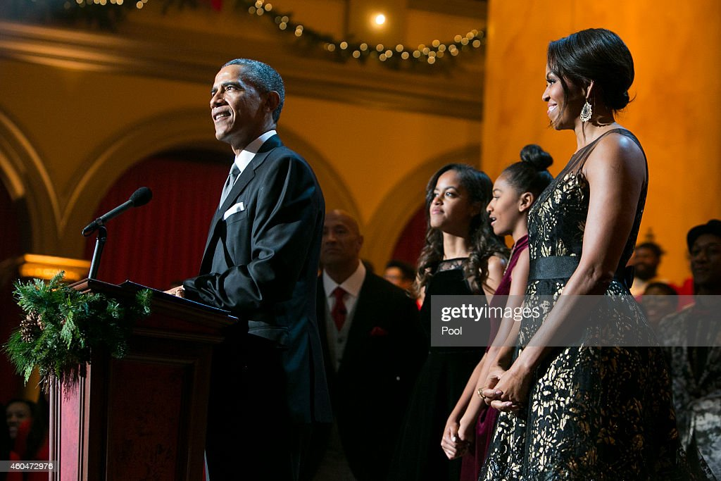 U.S. President Barack Obama, first lady Michelle Obama, and daughters Malia and Sasha join the performers on stage during TNT's 'Christmas in Washington' program on December 14, 2014 in Washington, DC. Proceeds from the concert will go to Children's National Medical Center.