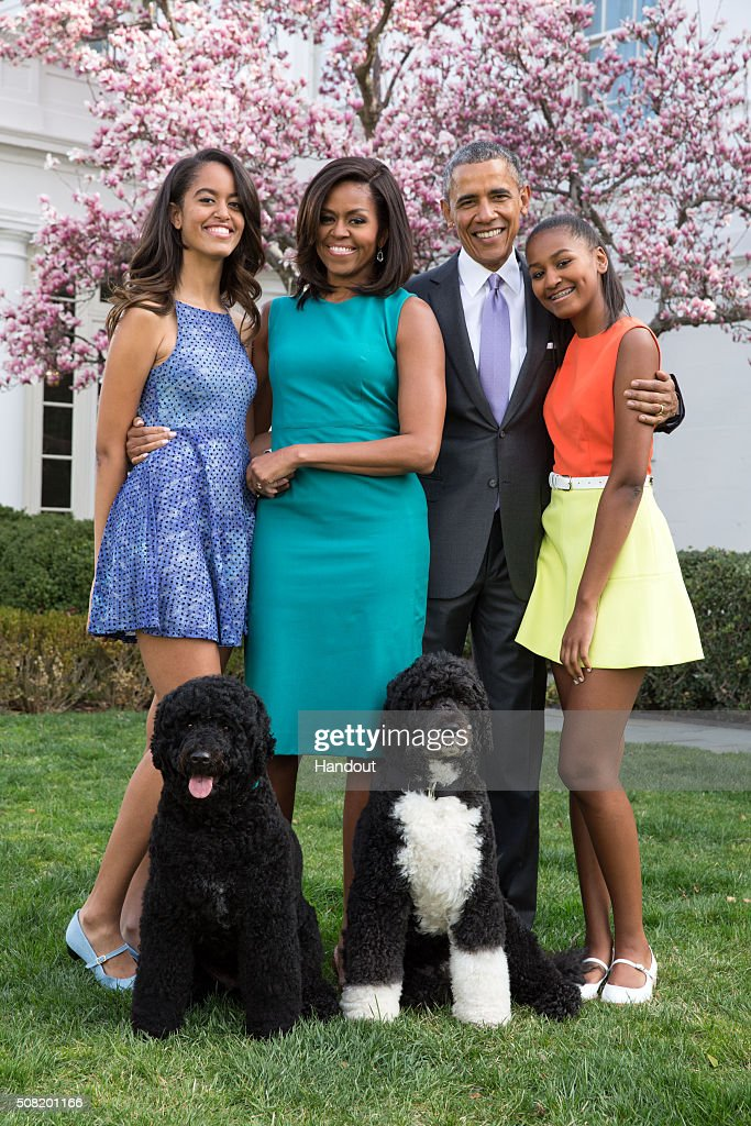 U.S. President Barack Obama, First Lady Michelle Obama, and daughters Malia (L) and Sasha (R) pose for a family portrait with their pets Bo and Sunny in the Rose Garden of the White House on Easter Sunday, April 5, 2015 in Washington, DC.