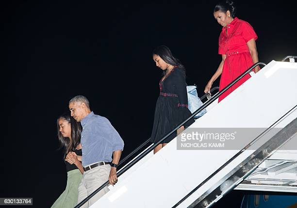 US President Barack Obama First Lady Michelle Obama and daughters Sasha and Malia arrive at Joint Base Pearl HarborHickam in Honolulu on December 16...