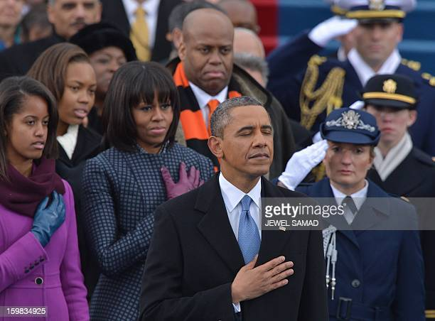 US President Barack Obama First Lady Michelle Obama and family members listen to Beyonce sing the National Anthem during the 57th Presidential...