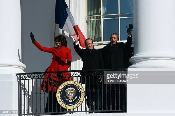 US President Barack Obama First Lady Michelle Obama and French President Francois Hollande wave during a ceremony on the South Lawn of the White...