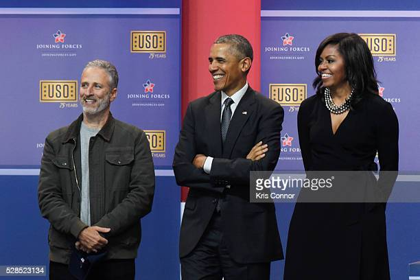 President Barack Obama First Lady Michelle Obama and Jon Stewart speak during the 75th Anniversary USO Show at Joint Base Andrews on May 5 2016 in...
