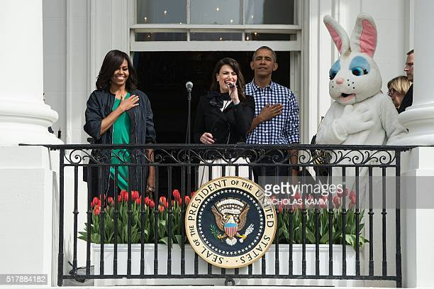 US President Barack Obama First Lady Michelle Obama and the Easter Bunny listen to Idina Menzel sing the national anthem at the annual Easter Egg...