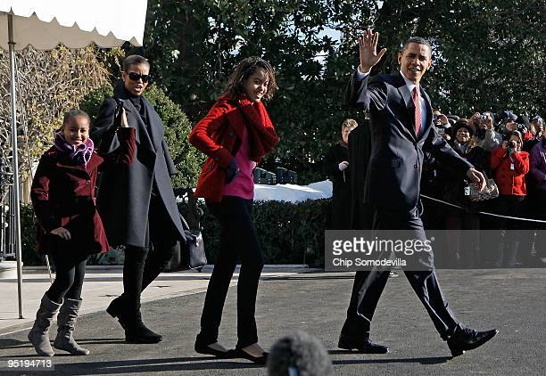 S President Barack Obama first lady Michelle Obama and their children Sasha and Malia leave the White House December 24 2009 in Washington DC The...