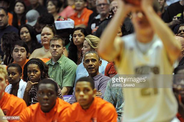 US President Barack Obama First Lady Michelle Obama and their daughter Sasha watch the Oregon State University vs University of Akron college...