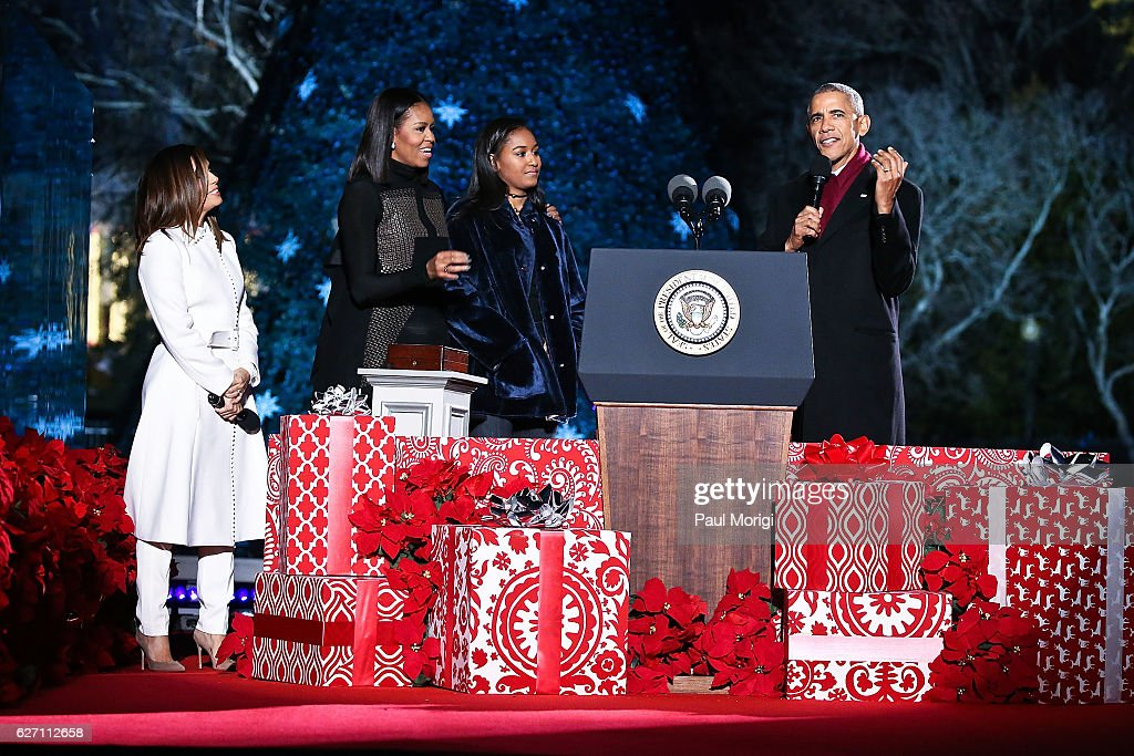 President Barack Obama, First Lady Michelle Obama and their daughter Sasha join host Eva Longoria (L) onstage during the 94th Annual National Christmas Tree Lighting Ceremony on the Ellipse in President's Park on December 1, 2016 in Washington, DC.