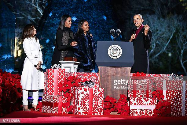 President Barack Obama First Lady Michelle Obama and their daughter Sasha join host Eva Longoria onstage during the 94th Annual National Christmas...