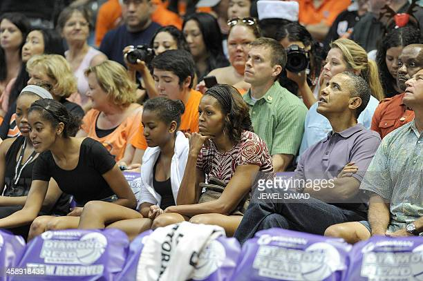 US President Barack Obama First Lady Michelle Obama and their daughters Malia and Sasha watch the Oregon State University vs University of Akron...