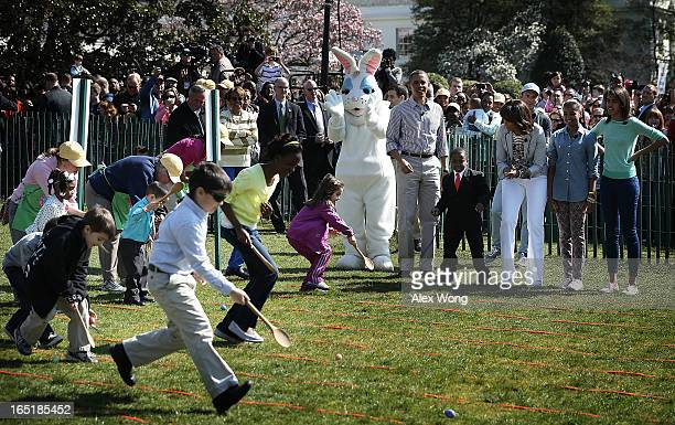S President Barack Obama first lady Michelle Obama daughters Sasha and Malia motherinlaw Marian Robinson Robby Novak who also known as the Kid...