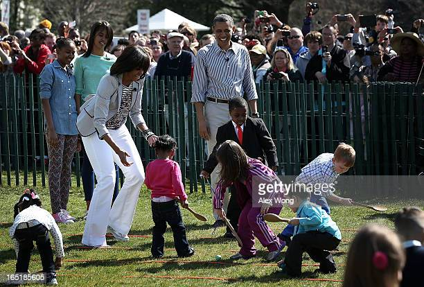 S President Barack Obama first lady Michelle Obama daughters Sasha and Malia and Robby Novak who also known as the Kid President watch as children...