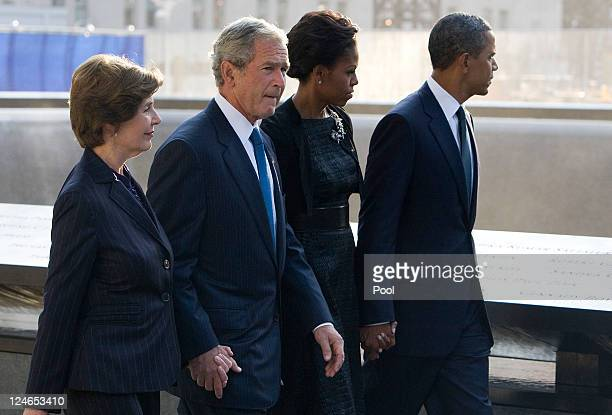 S President Barack Obama first Lady Michelle Obama former President George W Bush and former first lady Laura Bush walk past the North Pool of the...
