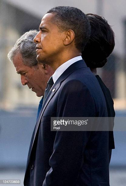 S President Barack Obama first lady Michelle Obama former President George W Bush and former first lady Laura Bush look out at the North Pool of the...