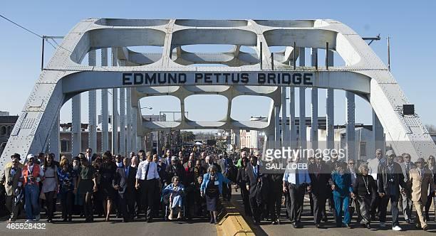 President Barack Obama , First Lady Michelle Obama , former US President George W. Bush , Laura Bush , and US Representative John Lewis , Democrat of...