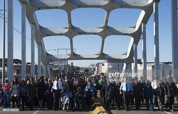 President Barack Obama , First Lady Michelle Obama , former US President George W. Bush , Laura Bush and US Representative John Lewis , Democrat of...