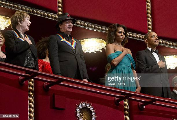 US President Barack Obama First Lady Michelle Obama Kennedy Center Honorees musician Carlos Santana and actress Shirley MacLaine listen to the...