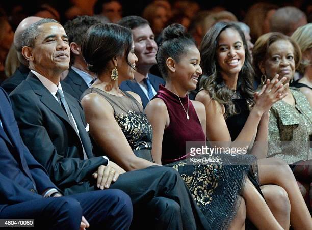 President Barack Obama, First Lady Michelle Obama, Sasha Obama, and Malia Obama attend TNT Christmas in Washington 2014 at the National Building...