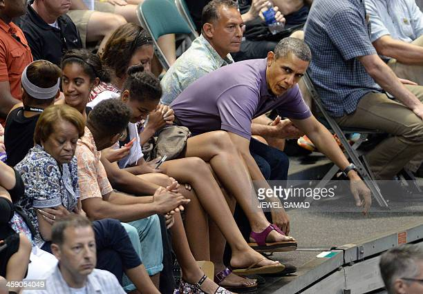 US President Barack Obama First Lady Michelle Obama their daughters Sasha and Malia and other family members watch the Oregon State University vs...
