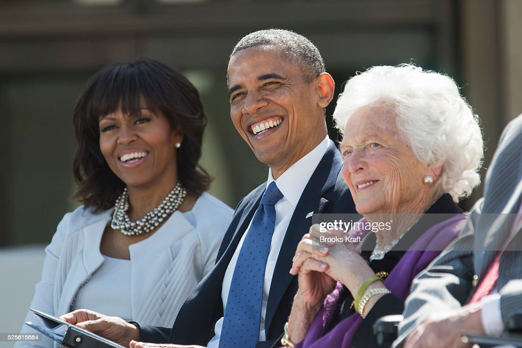 President Barack Obama, first lady Muichelle Obama and former first lady Barbara Bush share a laugh at the dedication of the George W. Bush presidential library on the campus of Southern Methodist University in Dallas.