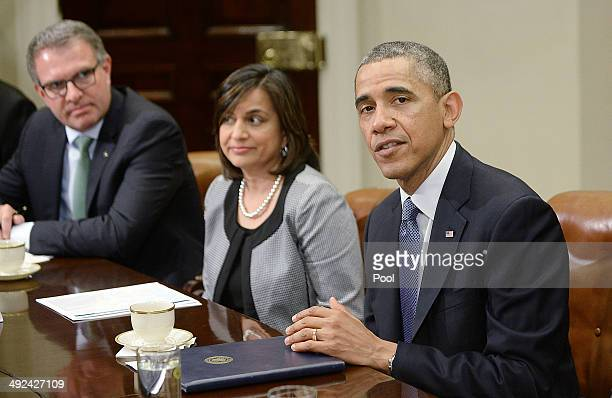 US President Barack Obama flanked by Ravila Gupta president of Umicore USA and Carsten Spohr Chairman and CEO Deutsche Lufthansa speaks with business...