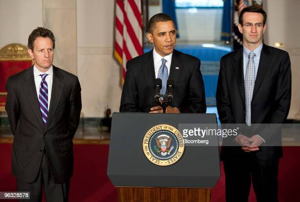 US President Barack Obama flanked by Timothy Geithner treasury secretary left and Peter Orszag director of the Office of Management and Budget as he...