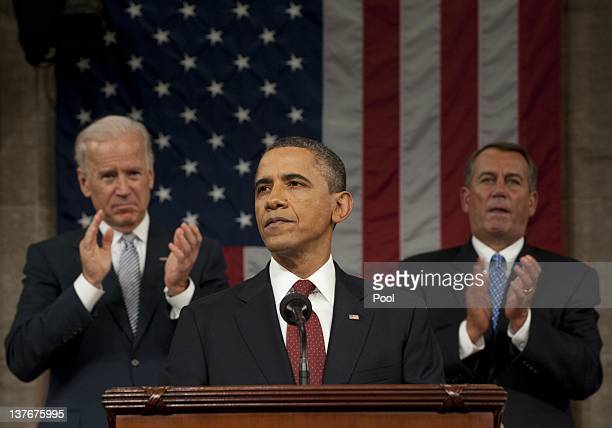 S President Barack Obama flanked by Vice President Joe Biden and House Speaker John Boehner delivers his State of the Union address before a joint...