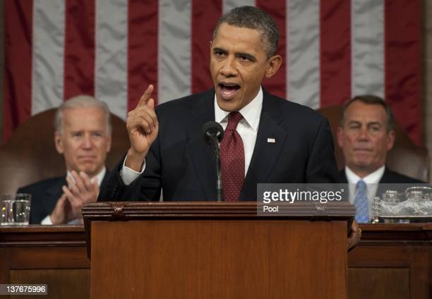 President Barack Obama, flanked by Vice President Joe Biden and House Speaker John Boehner , delivers his State of the Union address before a joint...