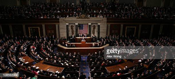 S President Barack Obama flanked by Vice President Joe Biden and Speaker of the House John Boehner addresses a Joint Session of Congress while...