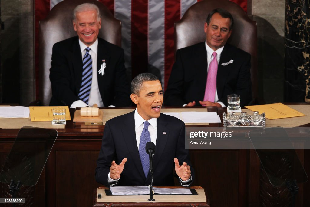 U.S. President Barack Obama, flanked by Vice President Joe Biden (L) and Speaker of the House John Boehner (R-OH), addresses a Joint Session of Congress while delivering his State of the Union speech January 25, 2011 in Washington, DC. During his speech Obama was expected to focus on the U.S. economy and increasing education and infrastructure funding while proposing a three-year partial freeze of domestic programs and $78 billion in military spending cuts.