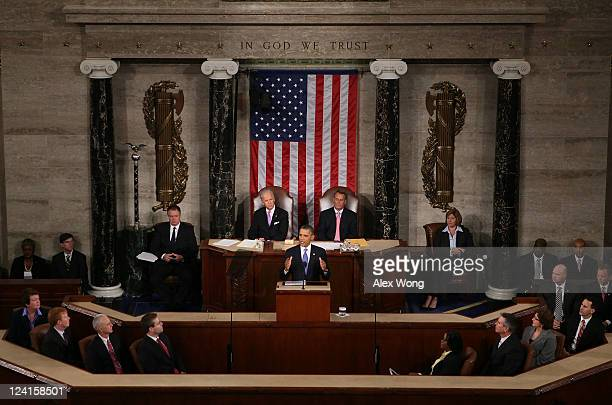 S President Barack Obama flanked by Vice President Joe Biden and Speaker of the House John Boehner addresses a Joint Session of Congress at the US...