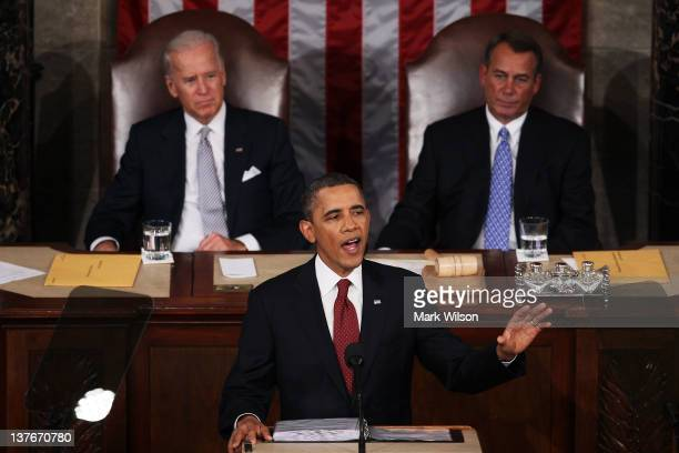 S President Barack Obama flanked by Vice President Joe Biden and Speaker of the House John Boehner delivers his State of the Union address on January...
