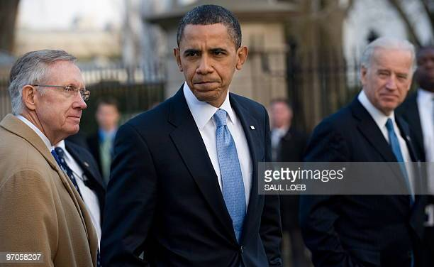 US President Barack Obama flanked by Vice President Joe Biden and Senate Majority Leader Harry Reid reacts to a question as he walks to the White...