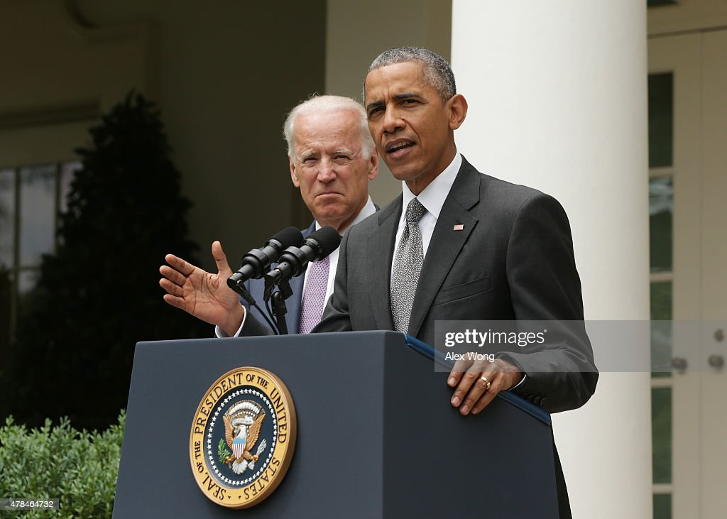 U.S. President Barack Obama, flanked by Vice President Joe Biden, gives a statement on the Supreme Court health care decision in the Rose Garden at the White House on June 25, 2015 in Washington, DC. The Supreme Court upheld the Obama health care subsidies in a 6-3 ruling.