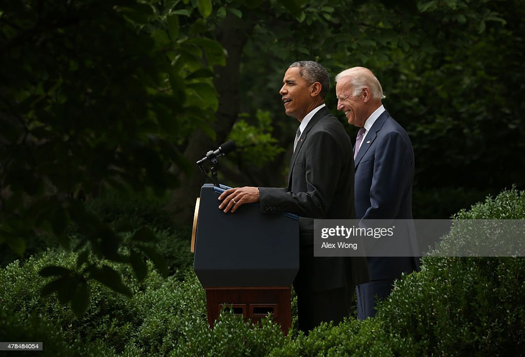 U.S. President Barack Obama (L), flanked by Vice President Joe Biden (R), gives a statement on the Supreme Court health care decision in the Rose Garden at the White House on June 25, 2015 in Washington, DC. The Supreme Court upheld the Obama health care subsidies in a 6-3 ruling.