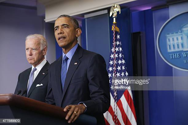 S President Barack Obama flanked by Vice President Joe Biden makes a statement regarding the shooting in Charleston South Carolina June 18 2015 at...