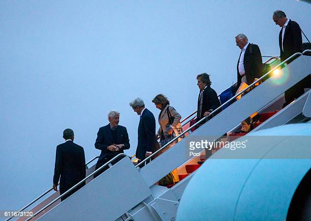 President Barack Obama followed by former President Bill Clinton Secretary of State John Kerry and House Minority Leader Nancy Pelosi walk off Air...