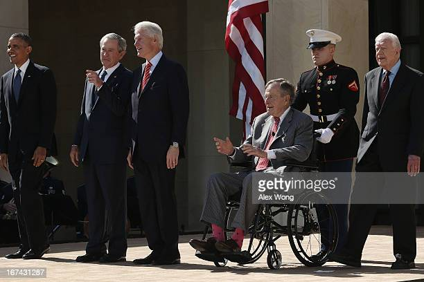 US President Barack Obama former President George W Bush former President Bill Clinton former President George HW Bush and former President Jimmy...
