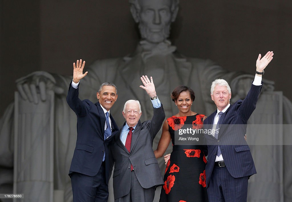 U.S. President Barack Obama, former president Jimmy Carter, first lady Michelle Obama, and former president Bill Clinton wave as they leave at the end of the Let Freedom Ring ceremony at the Lincoln Memorial August 28, 2013 in Washington, DC. The event was to commemorate the 50th anniversary of Dr. Martin Luther King Jr.'s 'I Have a Dream' speech and the March on Washington for Jobs and Freedom.
