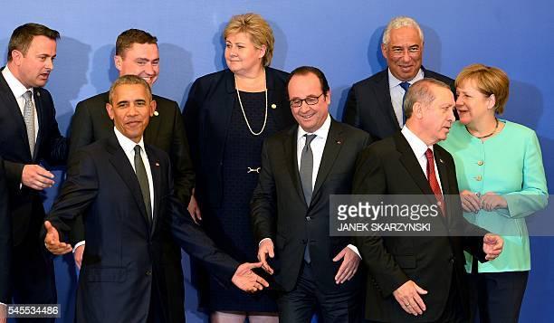 US President Barack Obama France's President Francois Hollande Turkish President Recep Tayyip Erdogan and German Chancellor Angela Merkel chat while...