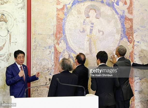 US President Barack Obama French President Francois Hollande and Japanese Prime Minister Shinzo Abe watch the reproduced mural of the Bamiyan which...
