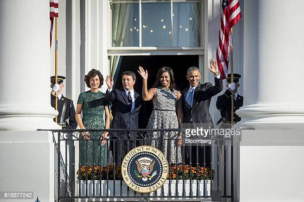 President Barack Obama, from right, First Lady Michelle Obama, Matteo Renzi, Italy's primer minister, and his wife Agnese Landini wave to the crowd...