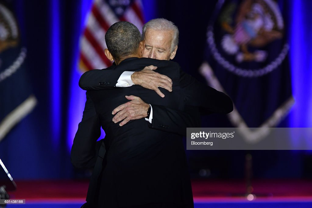 U.S. President Barack Obama, front, embraces U.S. Vice President Joe Biden after his farewell address in Chicago, Illinois, U.S., on Tuesday, Jan. 10, 2017. Obama blasted 'zero-sum' politics as he drew a sharp contrast with his successor in his farewell address Tuesday night, acknowledging that despite his historic election eight years ago his vision for the country will exit the White House with him. Photographer: Christopher Dilts/Bloomberg via Getty Images