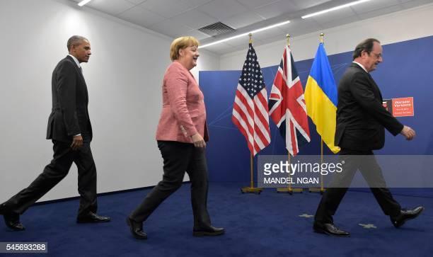 TOPSHOT US President Barack Obama German chancellor Angela Merkel and France's President Francois Hollande arrive for group photo after a quint...