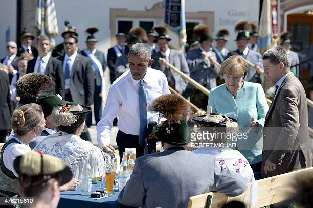 President Barack Obama , Germany's Chancellor Angela Merkel, her husband Joachim Sauer arrive at a breakfast meeting with local citizens dressed in...